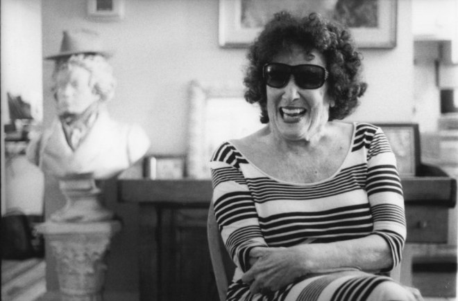 Faith, 91, laughs in her Adams Morgan apartment. (Photo by Eli Fosl)