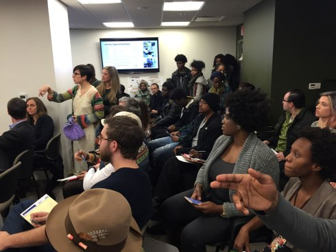 Artists at the D.C. Zoning Commission Hearing voice their opinions on the closing of Union Arts from the crowd. (Photo by Eli Fosl)