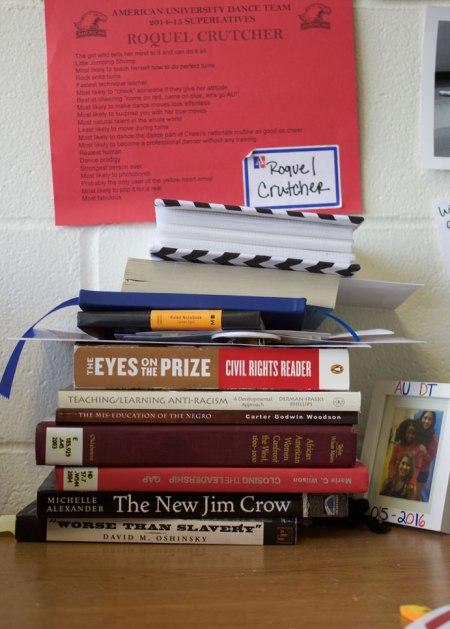 Books in Roquel's dorm room.