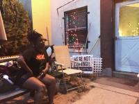 Schyla Pondexter-Moore at the weekly Empower DC meeting in front of an Occupy Barry Farm yard sign. Photo by Elijah Fosl
